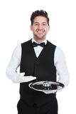 Waitperson Holding Service Bell Royalty Free Stock Images