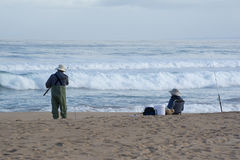 Senior Female and Male Surf Fishing, Waitpinga, South Australia. Waitpinga, South Australia, Australia: June 10, 2017: Male and female surf fishing on the beach Stock Photos