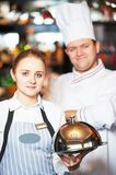 Waitres and chef in restaurant Stock Photography