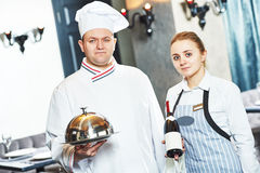 Waitres and chef in restaurant stock photo