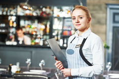 Waitres with menu. Waitress with menu at the indoor restaurant service royalty free stock images