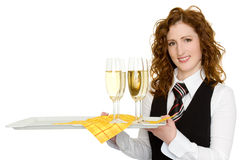 Waitress. A waitress with champagne glasses Royalty Free Stock Photography