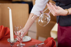 Waitress Arranging Wineglasses On Restaurant Table Stock Photo