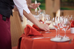 Waitress Arranging Wineglasses On Table Royalty Free Stock Photo