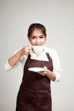 Waitress or barista  in apron drinking coffee Royalty Free Stock Images