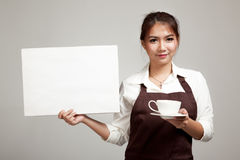 Waitress or barista  in apron  holding coffee and blank sign Royalty Free Stock Images