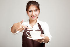 Waitress or barista  in apron  holding coffee Royalty Free Stock Images