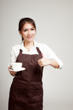 Waitress or barista  in apron  holding coffee Stock Image