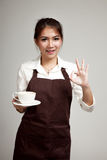 Waitress or barista  in apron  holding coffee Royalty Free Stock Photo
