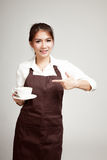 Waitress or barista  in apron  holding coffee Stock Photo