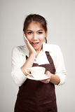 Waitress or barista  in apron  holding coffee Stock Photos