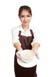 Waitress or barista  in apron  holding coffee Stock Images