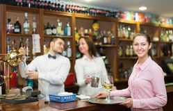 Waitress and barmen working Royalty Free Stock Image