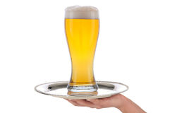 Waitress with beer glass on tray Royalty Free Stock Photo