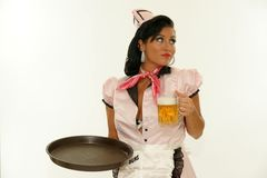 The waitress beer with a tray. Retro style isolated. Beer festival or a restaurant. Alcoholic beverages Stock Photos