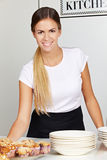 Waitress behind counter in café royalty free stock image