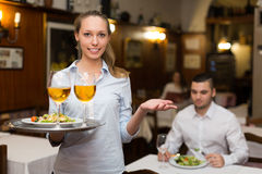 Waitress with beverages Royalty Free Stock Images