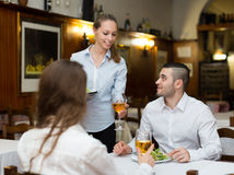 Waitress with beverages Stock Photo
