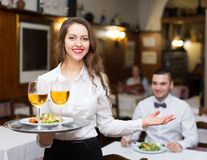 Waitress with beverages Royalty Free Stock Photography