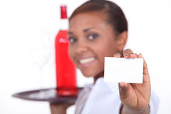 Waitress with a bottle Royalty Free Stock Image