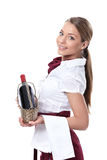 A waitress with a bottle of wine Stock Image