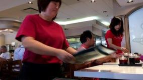 Waitress bringing menu for customer Royalty Free Stock Image