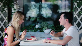 The waitress brought two desserts young people. stock footage