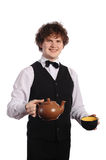 Waitress with brown ceramic teapot and black cup Stock Image
