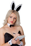 Waitress in bunny suit records your order Royalty Free Stock Photo