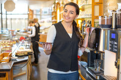 Waitress in caf� or restaurant and coffee machine Royalty Free Stock Image