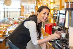 Waitress in cafe or restaurant and coffee machine Royalty Free Stock Photography