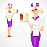 Waitress carrying beer on tray Stock Image