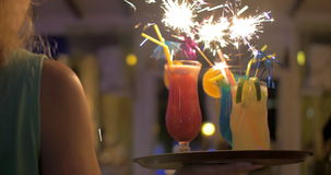 Waitress carrying cocktails with sparklers stock video footage
