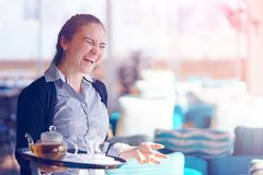The waitress is carrying tea. royalty free stock photo