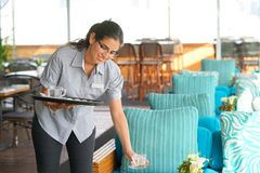 The waitress is carrying tea. stock image