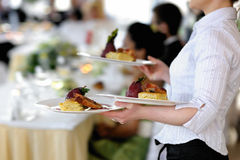 Waitress is carrying three plates royalty free stock photo