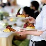 Waitress is carrying three plates Royalty Free Stock Photos