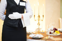 Waitress at catering service in restaurant Stock Photo