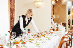 Waitress at catering work in a restaurant Stock Photo