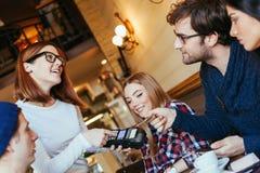Waitress Charging Customers Bill Royalty Free Stock Photography