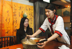 Waitress in Chinese style stock photos