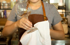 Waitress cleaning glasses in cafe shop stock photography