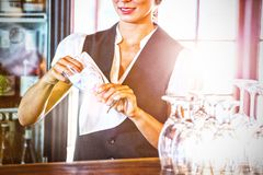 Waitress cleaning glasses royalty free stock image