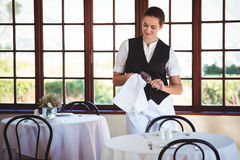 Waitress cleaning wineglass Royalty Free Stock Image