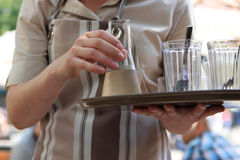 Waitress with decanter of liqueur Stock Image