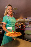 Waitress delivers breakfast at Peggy Sue's Americana Route 66 inspired diner in Yermo, California about eight miles outside of Bar Stock Images