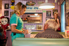 Waitress delivers breakfast at Peggy Sue's Americana Route 66 inspired diner in Yermo, California about eight miles outside of Bar Royalty Free Stock Photography
