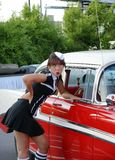 Waitress at drive-in restaurant. Picture of young woman waitress with a old car Stock Photo