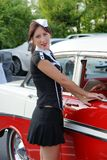 Waitress at drive-in restaurant. Picture of young woman waitress with a old car Royalty Free Stock Photo