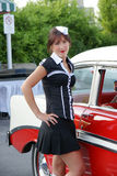 Waitress at drive-in restaurant. Picture of young woman waitress with a old car Stock Photos